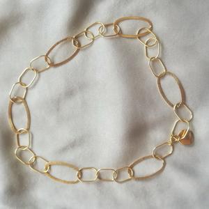 Collana in argento dorato con medaglietta