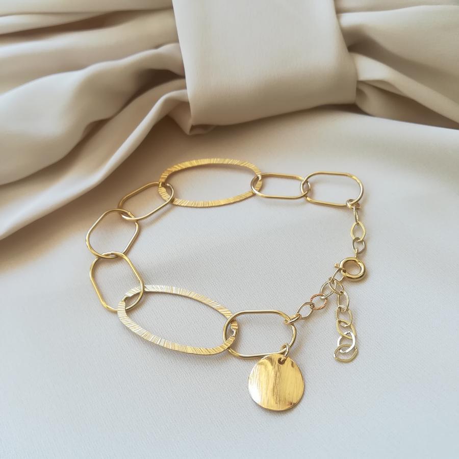 Bracciale in argento dorato con medaglietta