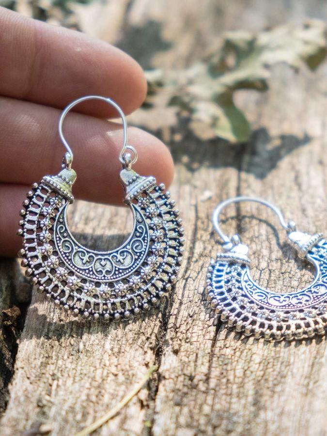 Round silver-plated ethnic style earrings with hook closure