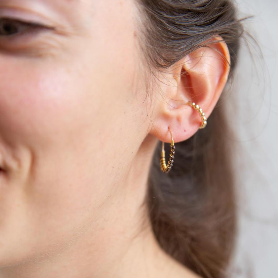 Ear cuff in argento dorato con palline