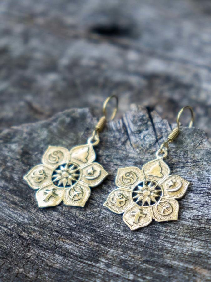 Brass flower earrings with ethnic symbols
