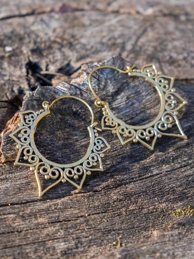 Round brass earrings with heart-shaped petal pattern and hook closure