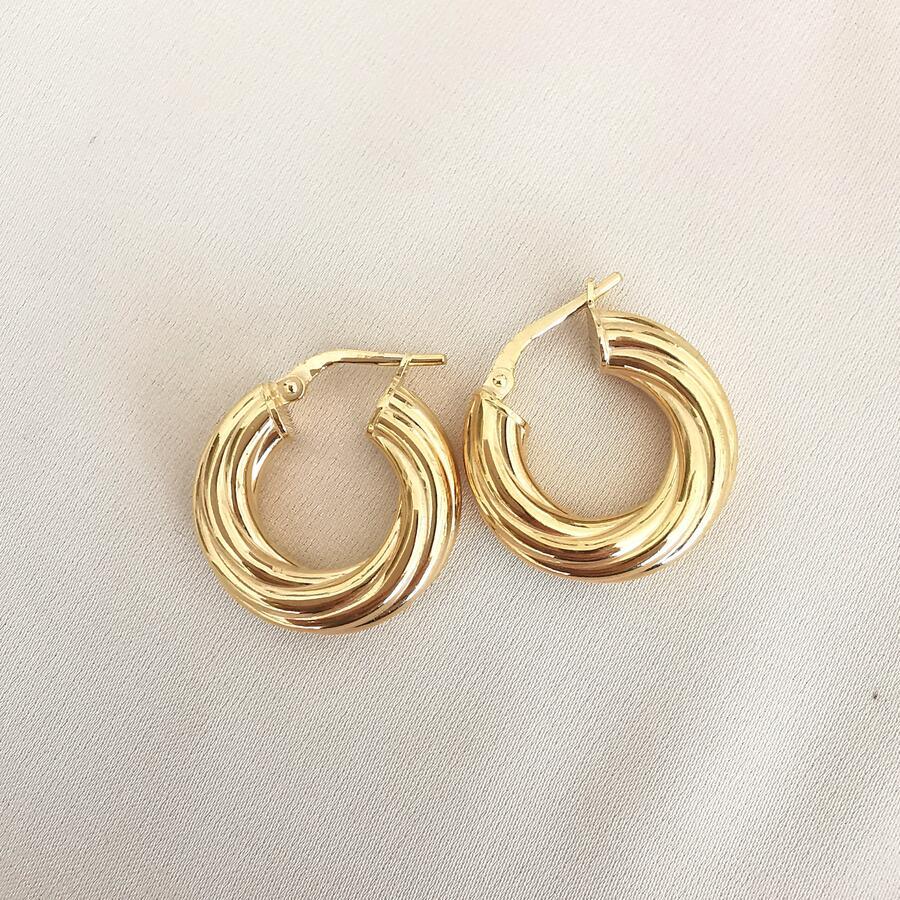 Cerchi in argento dorato rigati