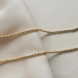 Collana con piccole sfere sfaccettate in argento dorato