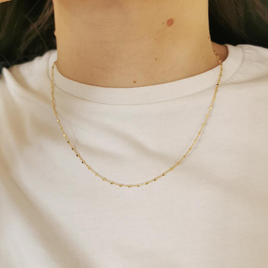Girocollo con piccoli dadini in argento dorato