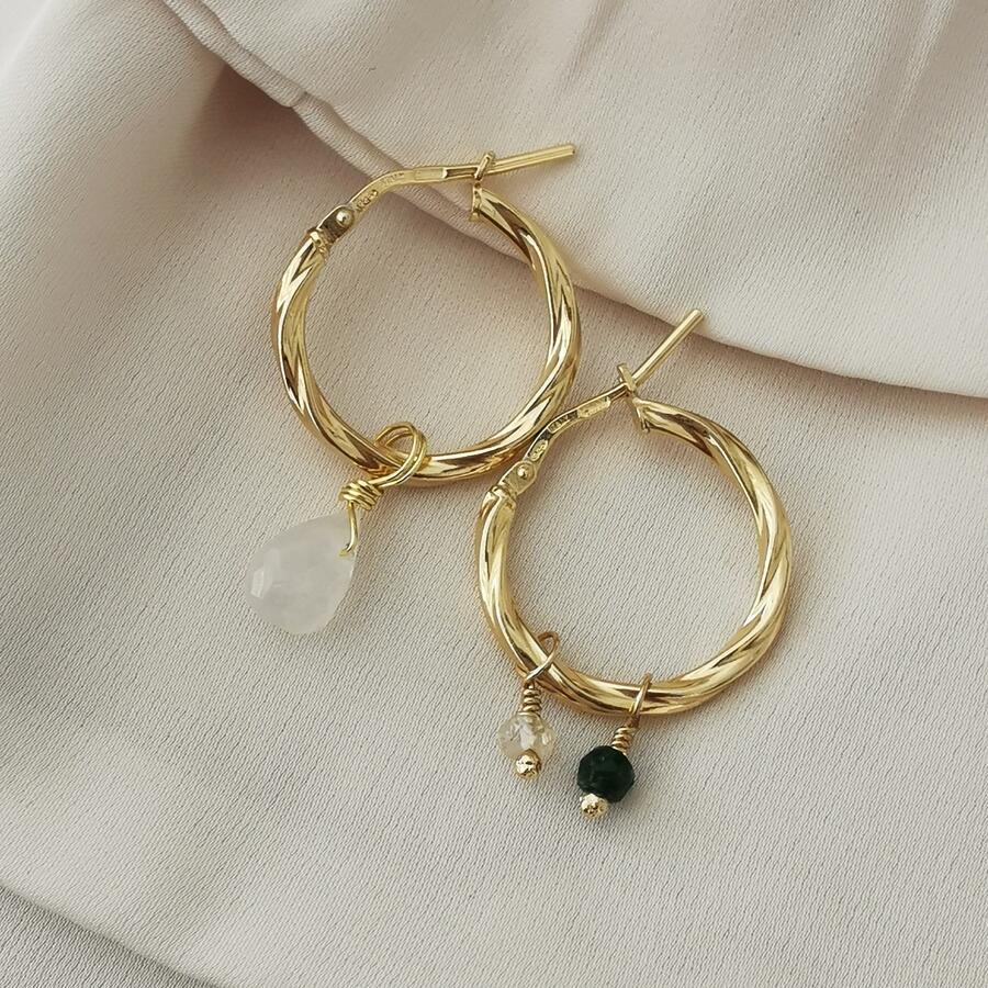 Cerchi in argento dorato ondulati