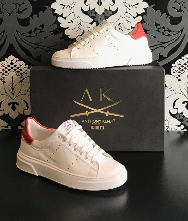 Sneakers uomo Anthony Kenji in pelle bianca riporto arancio