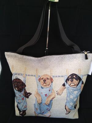 Borsa da spalla con cuccioli stesi ad asciugare